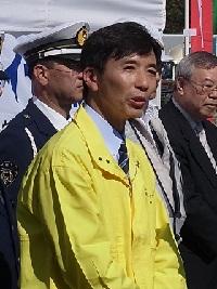 あいさつする倉田専務理事